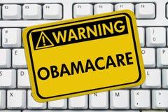 警告Obamacare 库存图片