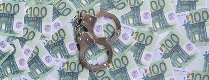 警察把在一套的谎言扣上手铐绿色金钱衡量单位o 库存照片