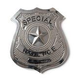 警察证章与裁减路线-储蓄照片 库存照片