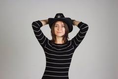 警长帽子的女孩 免版税图库摄影