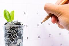 计划对在玻璃的保存的金钱在您的投资未来 免版税库存照片