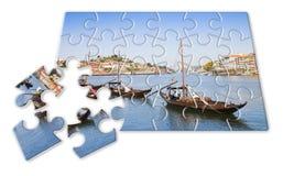 计划您的葡萄牙假日-在难题形状的概念-典型的葡萄牙小船以前使用运输著名口岸 免版税库存照片