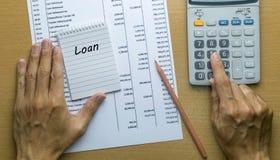 计划月度贷款偿还的人 库存图片