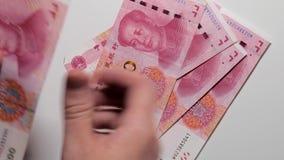 计数中国金钱, 100元钞票,中国货币,白色背景 影视素材