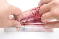 计数RMB的人 免版税库存照片