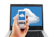计算与移动电话的云彩 免版税库存照片