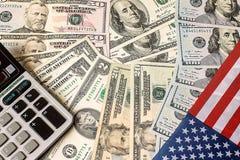 计算器、美元和美国旗子 免版税库存照片
