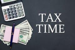 计算器和美元与消息税时间 免版税图库摄影