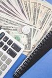 计算器和金钱 免版税库存图片