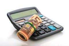 计算器和货币。 免版税库存图片