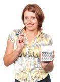 计算器笔微笑的妇女年轻人 免版税库存照片