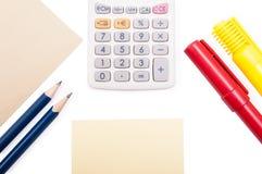计算器,写对象和纸在白色背景 免版税库存照片