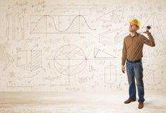 计算有手拉的背景的英俊的工程师 库存图片