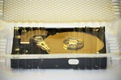 计算机光盘到透明塑胶容器里 免版税库存图片