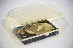 计算机光盘到透明塑胶容器里 免版税图库摄影