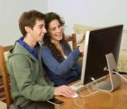 计算机夫妇少年 免版税库存照片