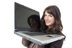 计算机女孩膝部顶层 库存图片