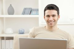 计算机家庭膝上型计算机人 免版税库存照片