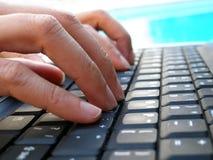 计算机手指关键键入 库存图片