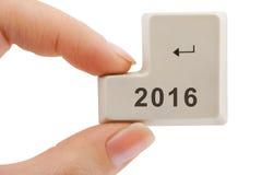 计算机按钮2016在手中 库存照片