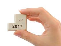 计算机按钮2017在手中 库存照片