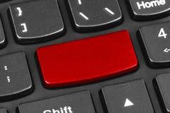 计算机有空白的红色钥匙的笔记本键盘 库存图片