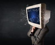 计算机爆炸在的显示器屏幕年轻人朝向 图库摄影