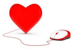 计算机老鼠被连接到红色心脏 免版税库存图片
