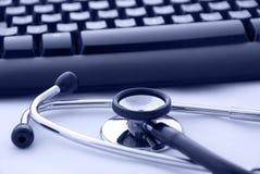 计算机键盘听诊器 免版税库存照片