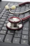 计算机键盘听诊器 库存照片
