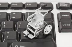 计算机键盘轮椅 库存图片