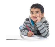 认为为答复的年轻学习的男孩 免版税图库摄影