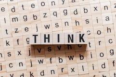 认为在立方体的词概念 免版税库存照片