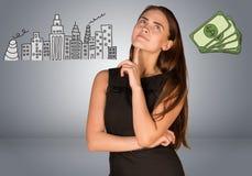 认为在金钱的美丽的女商人和 免版税图库摄影