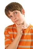 认为垂直的空白年轻人的男孩 库存图片
