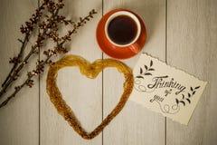 认为您-卡片 一杯茶和与芽的杏树分支 库存图片
