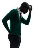 认为沉思懊恼剪影的非洲黑人 库存图片
