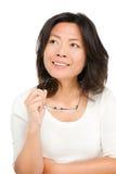 认为的中间变老的亚裔妇女 免版税图库摄影
