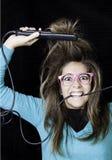 讨厌的妇女发型 库存照片