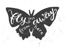 让远离这里在上写字的飞行在蝴蝶 库存照片