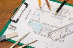 议院与制图圆规的楼面布置图 免版税库存照片