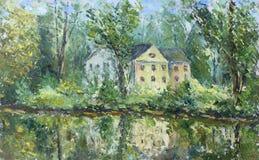 议院在河附近的秋天森林里 库存图片