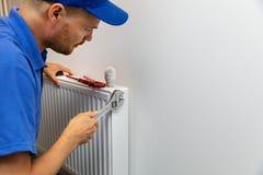 议院暖气安装幅射器的设施水管工 免版税图库摄影