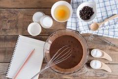 记录的菜单的,做的杯子蛋糕choc成份笔记本 库存图片