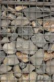 许多一起石头在笼子 免版税库存照片