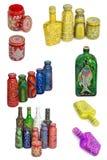 许多不同的瓶,在被隔绝的背景绘的被绘的小点 免版税库存照片