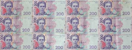 许多乌克兰货币钞票的样式的特写镜头与200 hryvnia面值的  在事务的背景图象在Ukr 库存照片