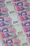 许多乌克兰货币钞票的样式的特写镜头与200 hryvnia面值的  在事务的背景图象在Ukr 免版税库存照片