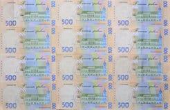 许多乌克兰货币钞票的样式的特写镜头与500 hryvnia面值的  在事务的背景图象在Ukr 免版税库存图片