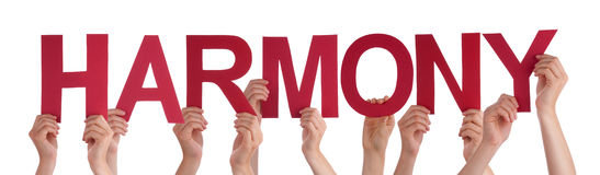 许多人手举行红色平直的词和谐 免版税库存照片